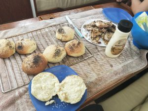 Fresh baked poppy seed and sesame seed rolls, fresh caught yellow fin tuna fish burgers.