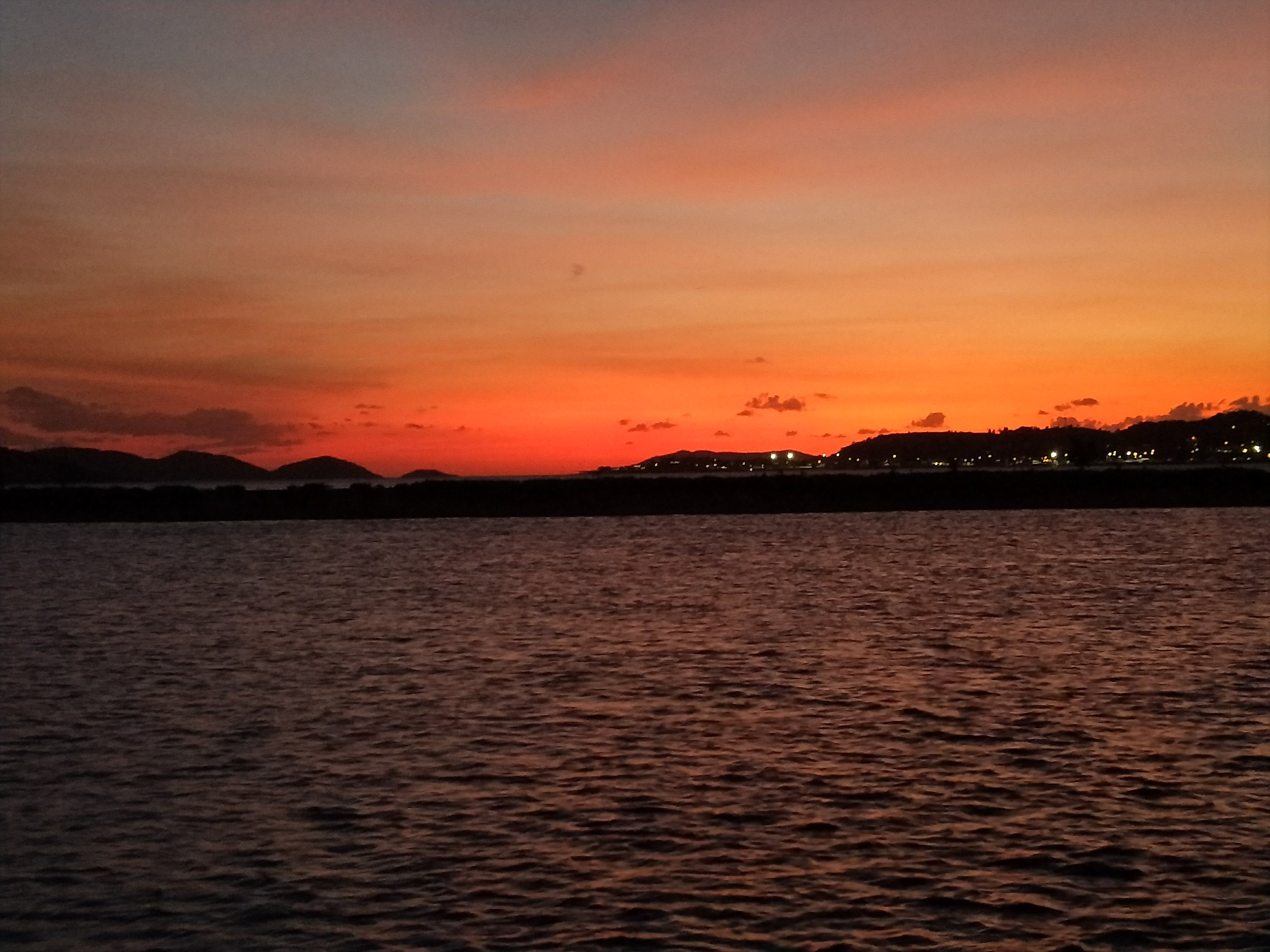 The sun setting over Thursday Island as viewed from Horn Island anchorage.